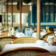 Stockfoto: Empty tables at outdoor restaurant