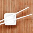 Chopsticks on a white ceramic cup — Stock Photo