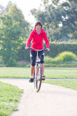 Woman rides a bicycle — Stock Photo