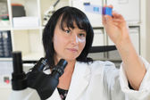 Woman in a biological laboratory — Stockfoto