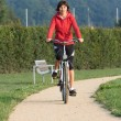 Healthy active Woman on a bike ride Outdoors — Stock Photo #31301757