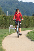 Healthy active Woman on a bike ride Outdoors — Стоковое фото