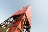 Looking up derrick, mast of a land drilling rig — Stock Photo