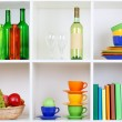 Book shelf with bottles and books — Stock Photo