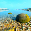 Stock Photo: Stone egg on shore of Gulf