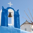 Windmill and a cross with a bell, Santorini — Stock Photo #33949315