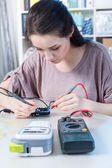 Laboratory assistant girl in electronic lab — Stock Photo