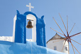 Windmill and a cross with a bell, Santorini — Stock Photo