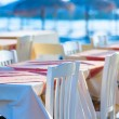 Street cafe tables on the coast, Santorini Greece — Stock Photo