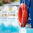 Lifebuoy in hotel pool — Stock Photo