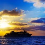 Oceanic cruise ship at sunset — Stock Photo #34955181