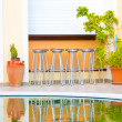 Bar chairs and a swimming pool — Stock Photo