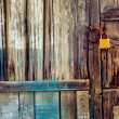 Old wooden door with lock — Stock Photo