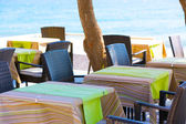 Restaurant on the beach with empty tables — Stock Photo