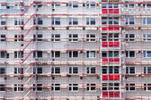 High building house in scaffolding — Stock Photo