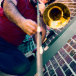 Man trombonist plays music on a city street — Stock Photo