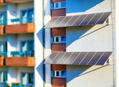 Solar panel to produce clean green electricity at the wall of a — Stock Photo