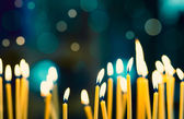 Church candles on the background bokeh — Stockfoto