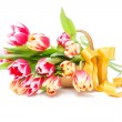 Flowers tulips in a wooden basket — Stock Photo #38078967