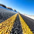 Yellow dividing line on asphalt road — Stock Photo #38078975