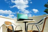 Laptop on balcony — Stockfoto