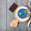 Stock Photo: Earth globe in a cup of coffee