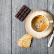 Espresso coffee, biscuits and chocolate — Stock Photo