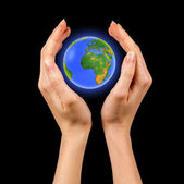 Earth globe in female hands — Stock Photo