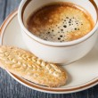 Cup of cappuccino coffee and cookies — Stock Photo #40065209