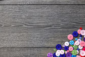 Colored buttons on wooden board, Colorful buttons, on old wooden — Stock Photo