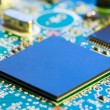 Stock Photo: Chips on a electronics printed circuit board