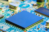Chips on a electronics printed circuit board — Foto Stock