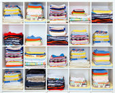 Towels, bed sheets and clothes on the shelf — Stock Photo