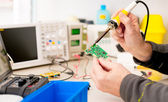 Repair and adjustment of the electronic device — Stock Photo