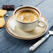 Cup of cappuccino coffee and cookies — Stock Photo