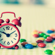 Alarm Clock and candy — Stock Photo