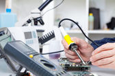 Repair of electronic devices, soldering parts — Stock Photo