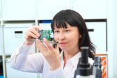 Woman with electronic micro processor — Stock Photo