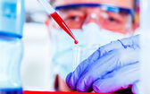 Scientist researching in laboratory — Stock Photo