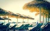 Parasols and sunbeds — Stock Photo