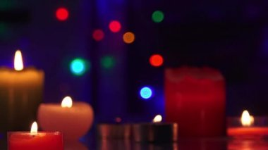 Tracking shot of christmas candles and flashing light bulbs on a background — Vidéo