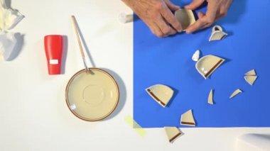 Repair bonding glue broken earthenware teacup, timelapse. Fix concept — Stockvideo