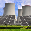 Solar energy panels before nuclear power plant — Stock Photo #12810686
