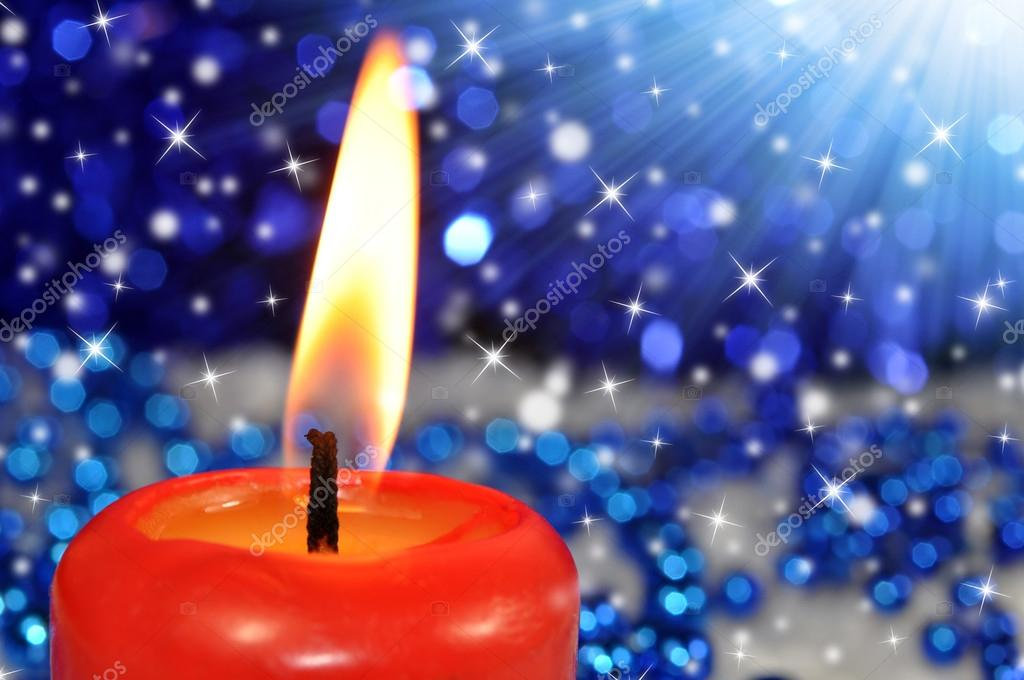 Closeup of a burning red candle — Stockfoto #13266240
