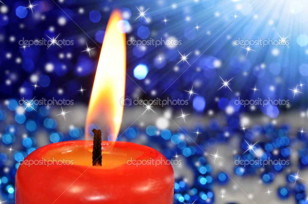Closeup of a burning red candle  Foto de Stock   #13266240