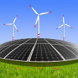 Solar energy panels and wind turbine — Stock Photo #13520221