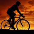 Cyclist riding a road bike — Stock Photo