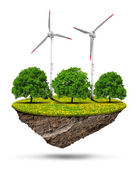 Little island with wind turbines and trees — Stock Photo