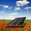 Solar energy panels and wind turbine — Stock Photo #14970399