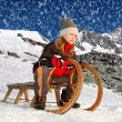 Girl on a sleigh — Stock Photo
